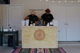 Far West Coffee Club founders Olaf Luna and Christopher Benninghoff pour coffee at their opening pop-up shop in Luna's garage.