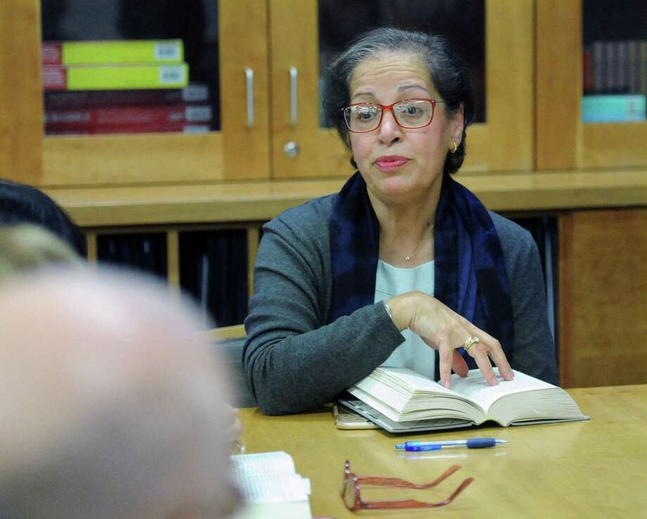 """Fereshteh Priou, right, leads the Proust Book Group meeting at the Byram Shubert Library in Greewich, Conn., Thursday, Dec. 7, 2017. The society has just finished reading Marcel Proust's """"In Search of Lost Time,"""" which is about 4,000 pages and seven volumes that they started reading in 2011. Photo: Bob Luckey Jr. / Hearst Connecticut Media / Greenwich Time"""