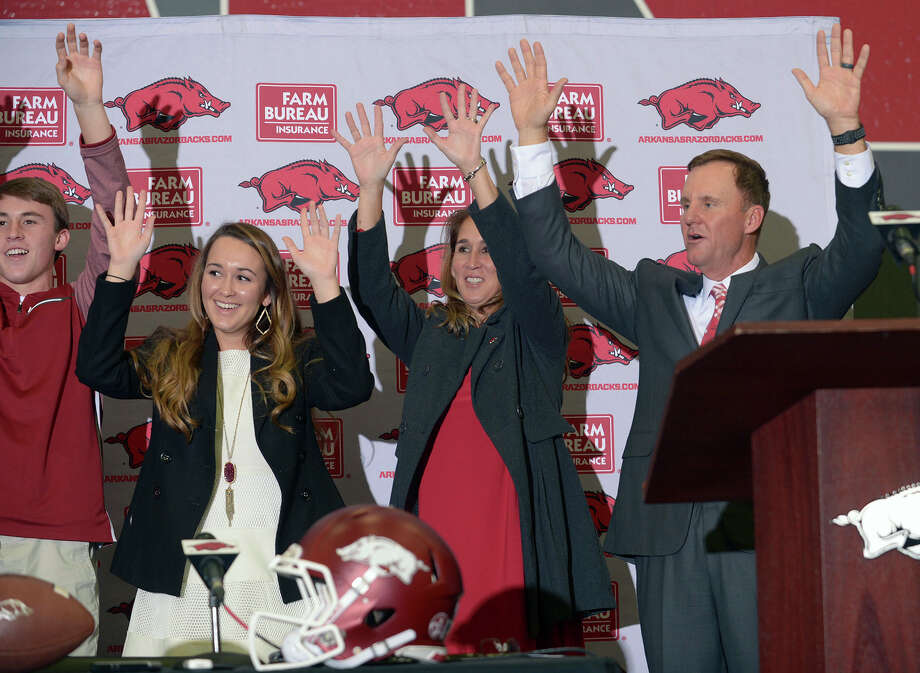 Newly hired University of Arkansas NCAA college football head coach Chad Morris, right, is joined by family members, from left, son Chandler, daughter Mackenzie and wife, Paula, as they lead a hog call during an introductory press conference in Fayetteville, Ark., Thursday, Dec. 7, 2017. (Andy Shupe/The Northwest Arkansas Democrat-Gazette via AP) Photo: Andy Shupe, Associated Press / The Northwest Arkansas Democrat-Gazette