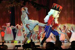 The Mouse King, played by Gabe Locke, left,  and the Nutcracker, played by Jake Groundwater rehearse the battle scene during a dress rehearsal at Danbury High School, Thursday, Dec. 7, 2017. This is the Danbury Music Centre's 50th anniversary of the Nutcracker. The show features 200 dancers and live music from the Danbury Symphony Orchestra.