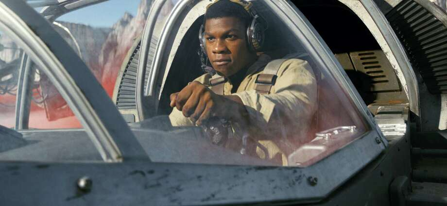 "This image released by Lucasfilm shows John Boyega as Finn in a scene from, ""Star Wars: The Last Jedi"" (Lucasfilm via AP) Photo: HONS / Copyright 2017 Industrial Light & Magic, a division of Lucasfilm Entertainment Company Ltd., All Rights Reserved"