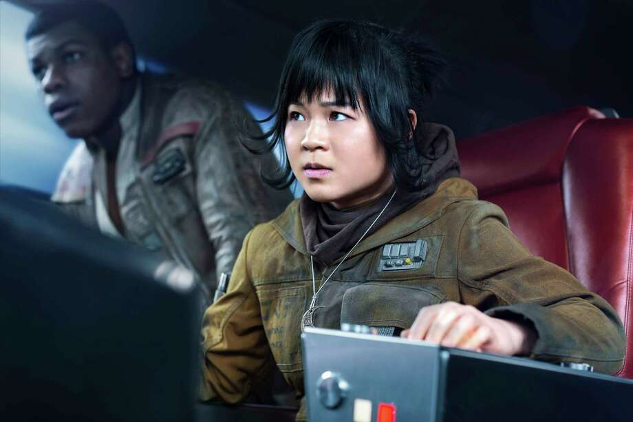 "This image released by Lucasfilm shows Kelly Marie Tran as Rose and John Boyega as Finn, left, in ""Star Wars: The Last Jedi,"" in theaters on Dec. 15. (Jonathan Olley/Lucasfilm via AP) Photo: Jonathan Olley, HONS / Copyright: 2016 Lucasfilm Ltd. & ™, All Rights Reserved."