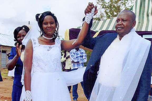 Pastor Samson Mulinge Mutuse celebrates his wedding to Evelyn Mueni Mulinge at Deliverance Church in Nthange, Kenya, on Nov. 25. Each lost a first spouse to AIDS.