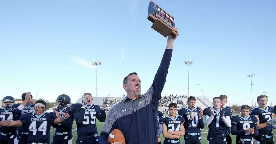 Cypress Christian's Head Coach Jacob holds up the championship trophy after defeating McKinney Christian for the TAPPS Division III State Championship December 8, 2017, in Waco, Tx. (Special Contributor, Jerry Larson) Photo: Jerry Larson