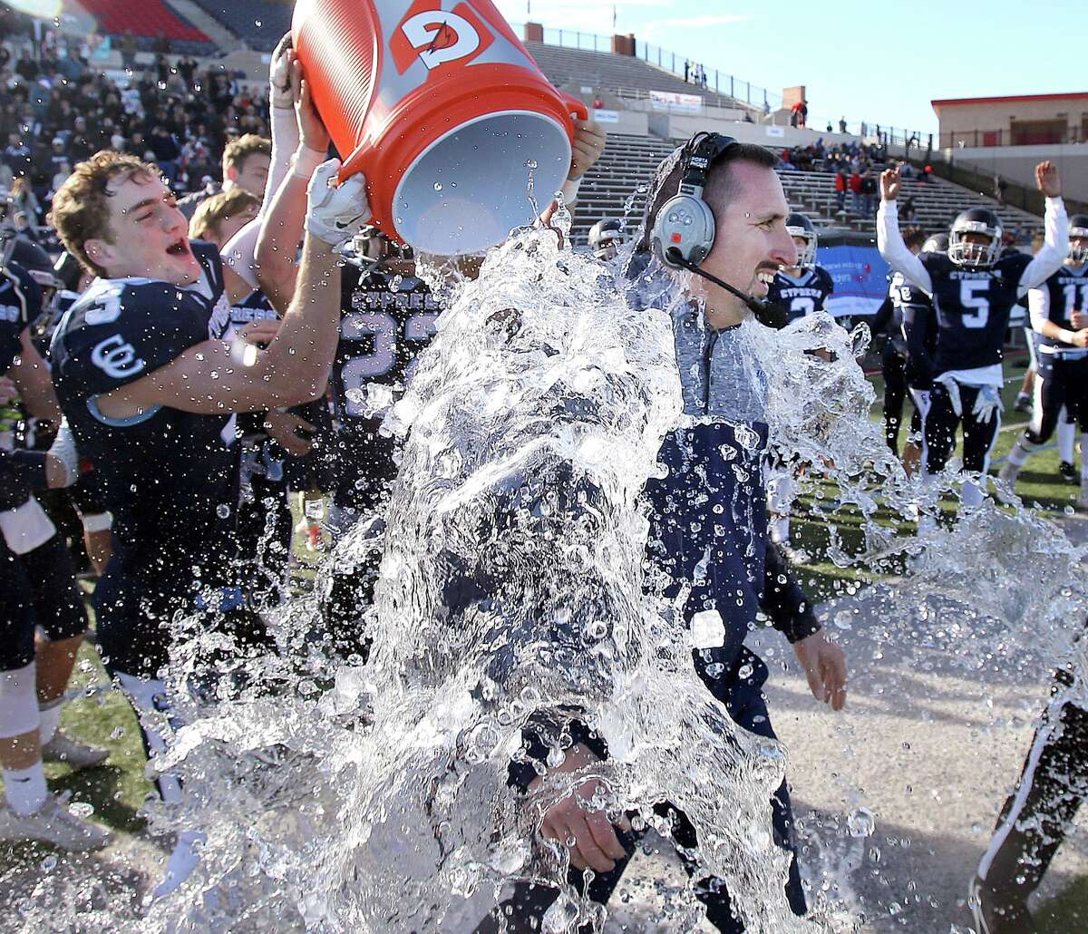 Cypress Christian's Head Coach Jacob Spenn is doused with water by John Ethan Baldwin (3) after defeating McKinney Christian for the TAPPS Division III State Championship December 8, 2017, in Waco, Tx. (Special Contributor, Jerry Larson)