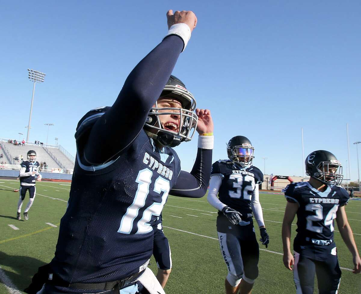 Cypress Christian's quarterback Joshua Holl (12) reacts after defeating McKinney Christian for the TAPPS Division III State Championship December 8, 2017, in Waco, Tx. (Special Contributor, Jerry Larson)