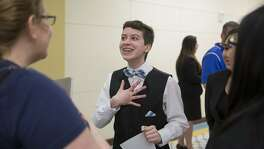 Jackson Farner laughs with his teammates after presenting about the Stonewall Riots at the San Antonio Regional History Fair at Texas A&M San Antonio in San Antonio, Texas on February 24, 2017.