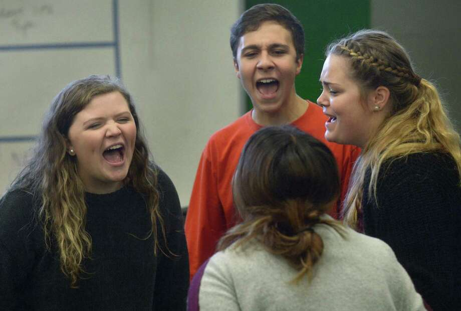 Choir members Anna Breault, Alec Cincotta, Sam Terrottelli, and Stephanie Vavalla, practice with The Norwalk High School Band as they rehearse for the annual Candlelight performance Thursday, December 7, 2017, at the school in Norwalk, Conn. The program which dates back to the 1930s will take place December 18th through the 20th. Photo: Erik Trautmann / Hearst Connecticut Media / Norwalk Hour