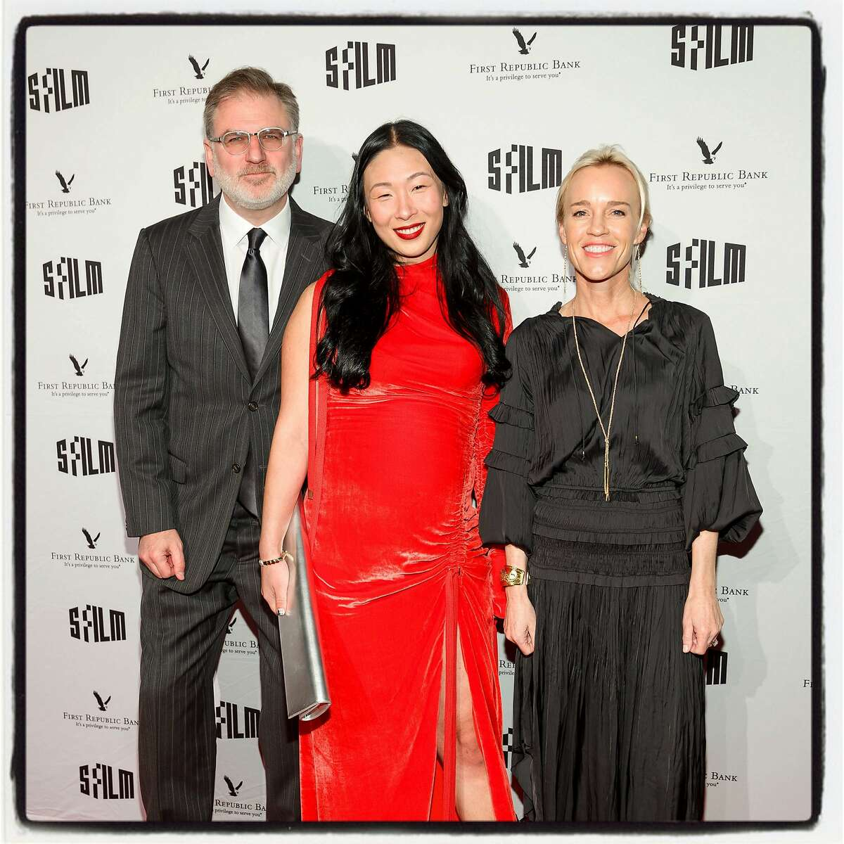 SFFilm Executive Director Noah Cowan with Film Awards cochairs Sonya Yu (left) and Heidi Fisher at Palace of Fine Arts. Dec. 5, 2017.