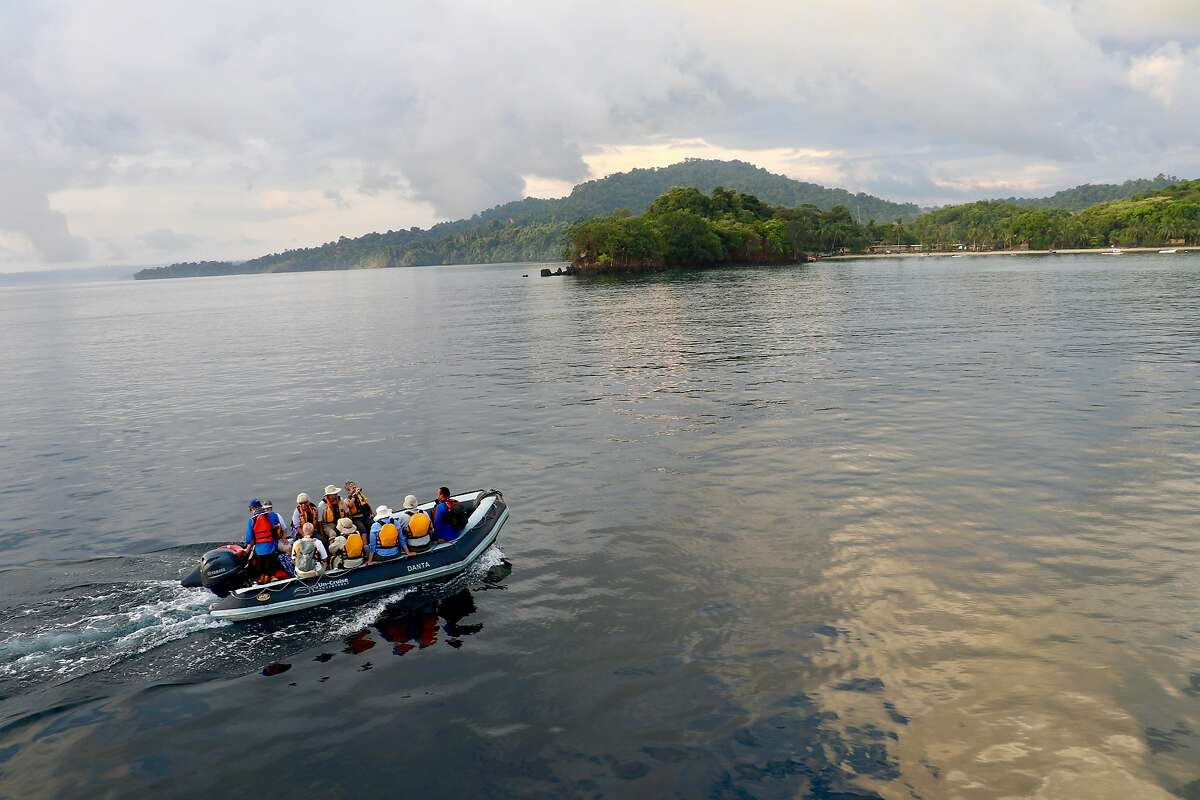 Each morning passengers board skiffs for excursions such as wildlife walks.