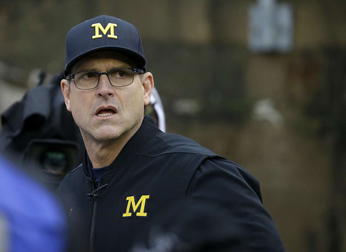 Michigan head coach Jim Harbaugh before an NCAA college football game against Wisconsin Saturday, Nov. 18, 2017, in Madison, Wis. (AP Photo/Aaron Gash)