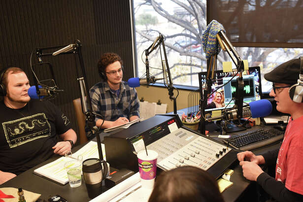 """From left, guests Lewis Busbee and Cory Maxwell talk with station manager Chistopher Brown (far right) during the """"Eyes on Psych"""" radio show Dec. 8, 2017, at the Recording Library of West Texas in Midland Shared Spaces. James Durbin/Reporter-Telegram"""