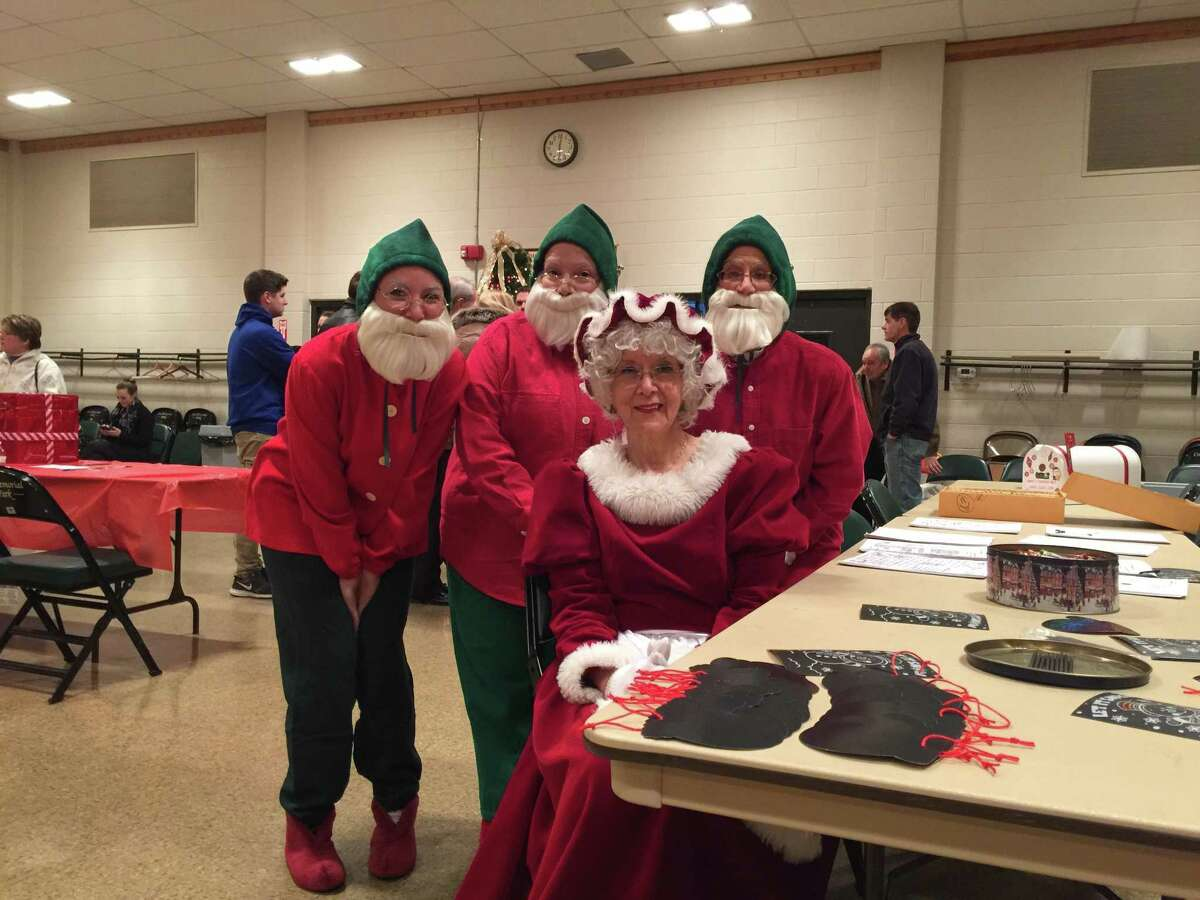 Torrington held its annual Toy Shower, an event that benefits Christmas Village by providing a toy for every child who visits, at the Coe Memorial Park Civic Center. Above, Mrs. Claus and her elves greet their guests.