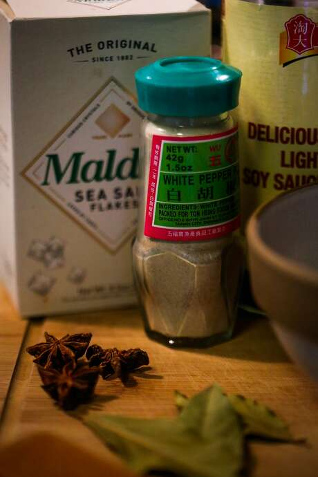 White pepper powder (center) and other ingredients on a cutting board in Daniel Situ's kitchen. Photo: Gabrielle Lurie, The Chronicle