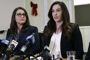 Jessica Yas Barker, right, makes a public allegation of inappropriate behavior by Assemblyman Matt Dababneh, D-Encino, during a news conference Monday, Dec. 4, 2017, in Sacramento, Calif. Dababneh denies the allegations. (AP Photo/Rich Pedroncelli)