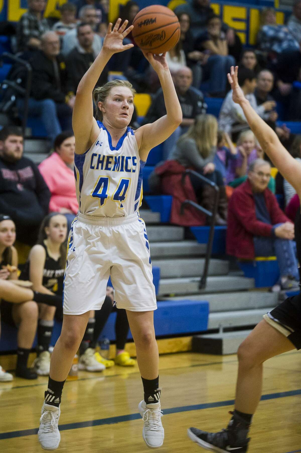 Midland senior Maddie Barrie takes a shot during a game against Bay City Western on Friday, Dec. 8, 2017 at Midland High School. (Katy Kildee/kkildee@mdn.net)
