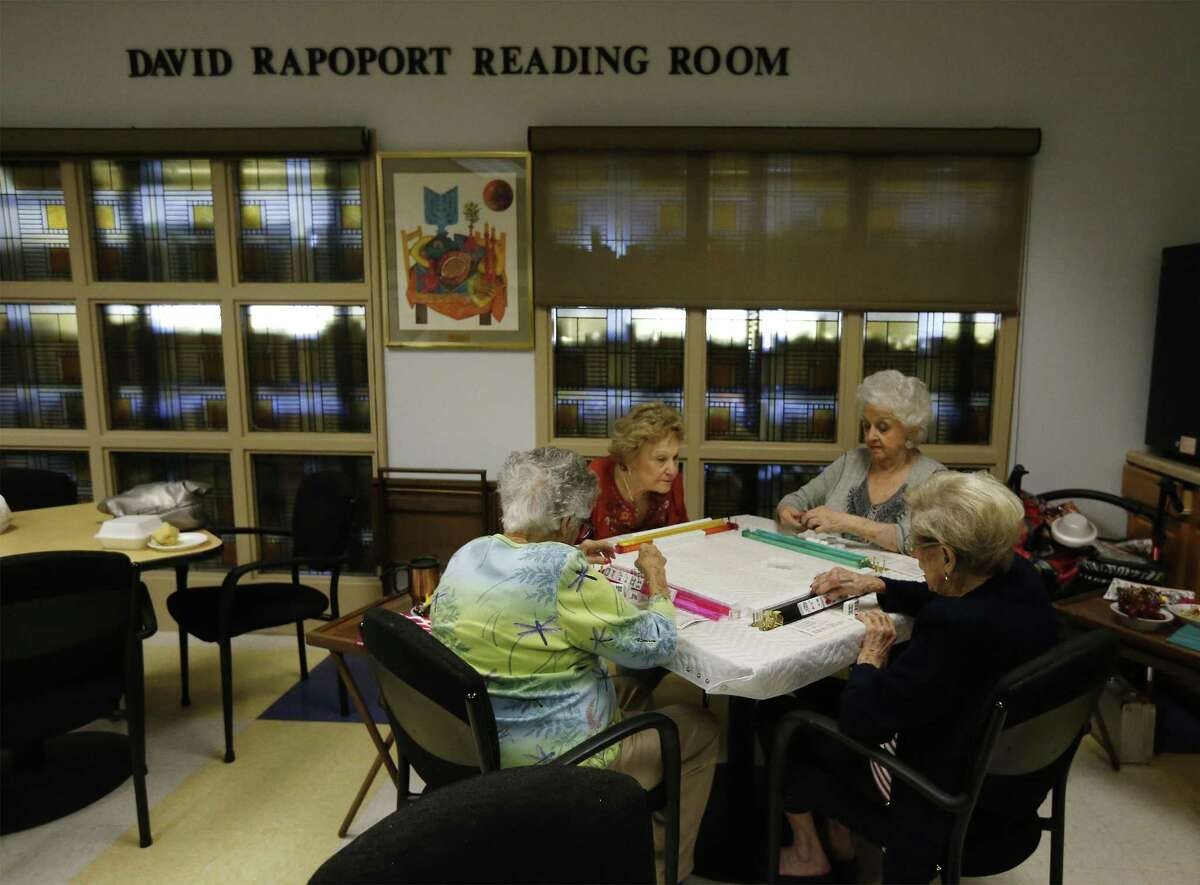Louise Bankler (from left), Pearl Gossen, Esta Zucker and Helen Kerman play mahjong on Thursday, Oct. 26, 2017. Each week at the Barshop Jewish Community Center, a group of women gather to play mahjong, an Asian game played with tiles. In recent months, mahjong has swept the JCC, yielding daily rounds between regular players including introductory classes and tournaments for all skill levels. Though the game can be competitive, the senior ladies enjoy the gathering to chat and socialize with one another. (Kin Man Hui/San Antonio Express-News)