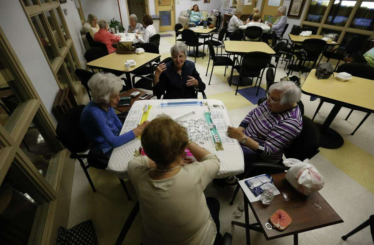 Felice Wolff (clockwise from left), Ida Rose Shapiro, Rose Williams and Shirley Tudzin play a game of mahjong on Thursday, Oct. 26, 2017. Each week at the Barshop Jewish Community Center, a group of women gather to play mahjong - an Asian game with tiles. In recent months, mahjong has swept the JCC, yielding daily rounds between regular players including introductory classes and tournaments for all skill levels. Though the game can be competitive, the senior ladies enjoy the gathering to chat and socialize with one another. (Kin Man Hui/San Antonio Express-News)