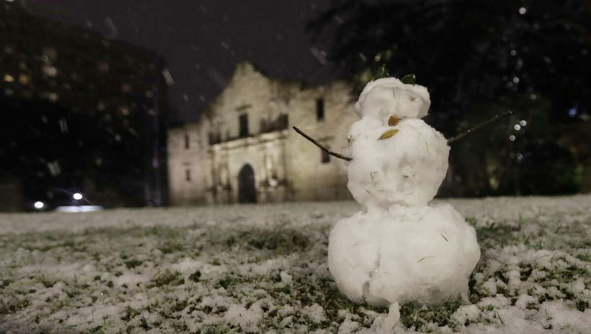 A small snowman stands in front of the Alamo as snow falls in downtown San Antonio Dec. 7. The National Weather Service said up to 2.5 inches of snow had been measured in the San Antonio area.