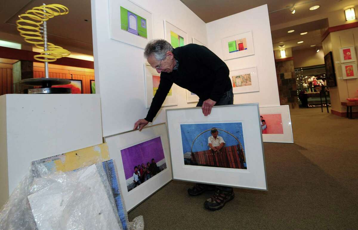 Norwalk resident and photographer Tom Kretsch, a retired teacher with a 36-year career in Norwalk Public Schools, with some of his images from Nicaragua on Friday. They are being exhibited at Gordon Fine Arts in the Stamford Town Center Mall. A reception Sunday will raise money for Norwalk's sister city in Nicaragua, Nagarote.