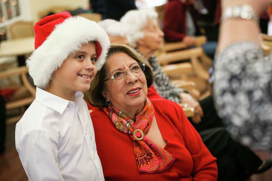 Wilkinson Elementary student Dylan Martin, left, poses for a photo with his grandmother Dolores Chatfield, right, on Friday, Dec. 8, 2017, at Carriage Inn-Conroe. Martin and his fellow Singing Pride choir members performed a series of holiday songs and dances for Carriage Inn residents like his grandmother. Photo: Michael Minasi, Staff Photographer / © 2017 Houston Chronicle