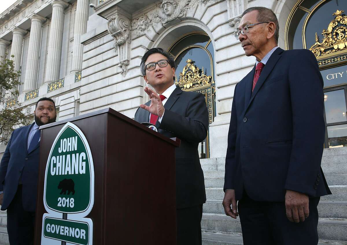 State treasurer and gubernatorial candidate John Chiang (middle) gets the support of supervisor Norman Yee (right) in front of SF city hall on Friday, December 8, 2017, in San Francisco, CA.