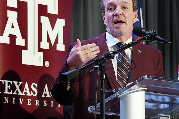 Jimbo Fisher speaks as he is introduced as Texas A&M's new head football coach,in Kyle Field's Hall of Champions Monday, Dec. 4, 2017 in College Station, Texas. Jimbo Fisher says the opportunity to coach Texas A&Ms was one he simply couldn't pass up. Fisher was lured away from Florida State, where he won a national championship in 2013, with a 10-year, $75 million contract at Texas A&M. (Dave McDermand/College Station Eagle via AP)