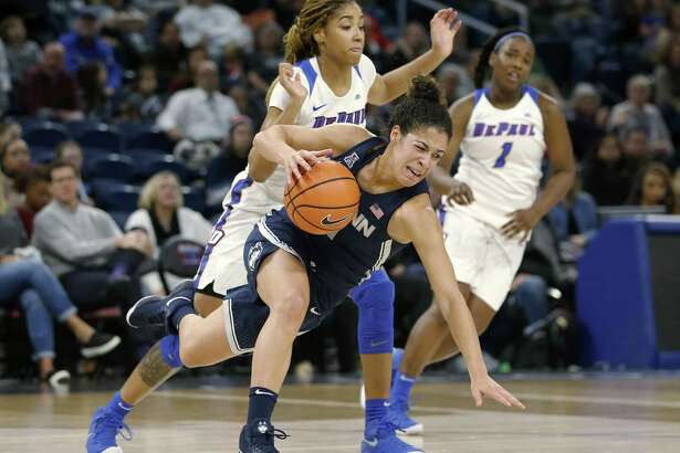UConn's Kia Nurse, front, is tripped by DePaul forward Mart'e Grays during the first half on Friday.