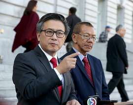 State treasurer and gubernatorial candidate John Chiang (left) gets the support of supervisor Norman Yee (right) in front of SF city hall on Friday, December 8, 2017, in San Francisco, CA.