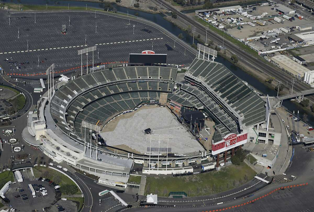 FILE - This Feb. 5, 2016, file photo shows the Oakland-Alameda County Coliseum, home to the Oakland Athletics, in Oakland, Calif. The Athletics are left to consider yet another site to build a new ballpark after the team's top choice of location near Laney College fell through with the board of Peralta Community College District. A's President Dave Kaval and his team had considered this the top spot and had engaged in conversations with community members, officials and business owners in the area in hopes of building a privately financed ballpark to open as soon as 2023. (AP Photo/Eric Risberg, File)