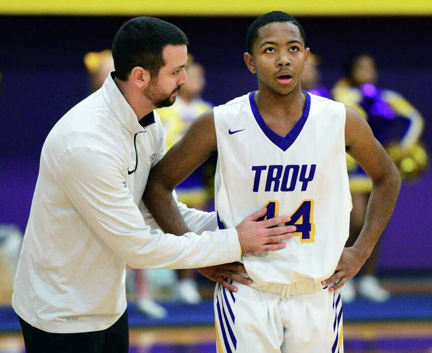 Troy head coach Greg Davis with player Nazaire Merritt during Friday night's game against Shaker High Dec. 8, 2017 in Troy, NY. (John Carl D'Annibale / Times Union)