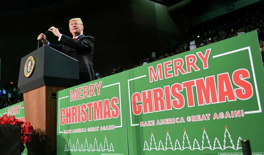 President Donald Trump takes to the stage at a campaign-style rally at the Pensacola Bay Center, in Pensacola, Fla., Friday, Dec. 8, 2017. Photo: Susan Walsh, AP / Copyright 2017 The Associated Press. All rights reserved.
