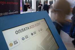 A  cryptocurrency ATM is displayed Friday at the CrytoSpace conference in Moscow.