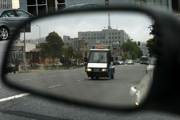 A parking enforcement officer patrols for expired meter violators on Bryant Street in San Francisco, Calif. on Friday, July 15 2011. Fees for both parking meters and violations have increased in recent years to make up for shortfalls in local governments' budgets.