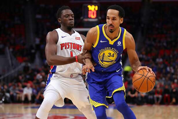 DETROIT, MI - DECEMBER 08: Shaun Livingston #34 of the Golden State Warriors drives around Reggie Jackson #1 of the Detroit Pistons during the first half at Little Caesars Arena on December 8, 2017 in Detroit, Michigan. NOTE TO USER: User expressly acknowledges and agrees that, by downloading and or using this photograph, User is consenting to the terms and conditions of the Getty Images License Agreement. (Photo by Gregory Shamus/Getty Images)