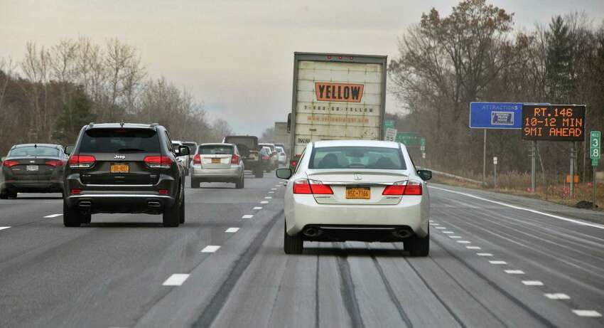 FILE - Northbound traffic slows as rush hour begins Friday Dec. 8, 2017 in Colonie, NY. (John Carl D'Annibale / Times Union)