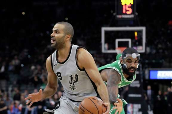 San Antonio Spurs guard Tony Parker (9) drives around Boston Celtics guard Kyrie Irving (11) during the first half of an NBA basketball game Friday, Dec. 8, 2017, in San Antonio. (AP Photo/Eric Gay)