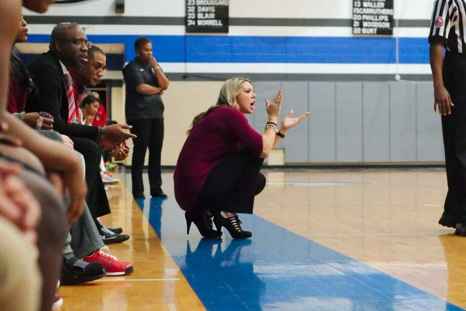 Pearland head coach Lauren Martens (near) encourages her team while Clear Springs head coach Pam Crawford watches the action in a non-district girls' basketball game Friday night. Photo: Kirk Sides