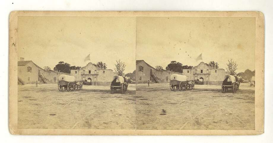 This stereograph image of the Alamo is attributed to early San Antonio photographer Henry A. Doerr. The two images looked three-dimensional when viewed through a stereoscope. Doerr probably took this photo circa 1861 or 1865, from the evidence of the U.S. flag, Alamo church roofline and carts delivering supplies to the Army Quartermaster's Depot, housed at the Alamo in those years. Photo: Courtesy / DeGolyer Library, Southern Methodist University