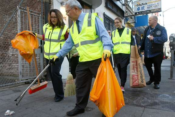 Mayor Ed Lee pitches in to help members of his multi-agency Fix-it Team clean up the sidewalks of the Tenderloin in San Francisco, Calif. on Wednesday, Nov. 29, 2017.