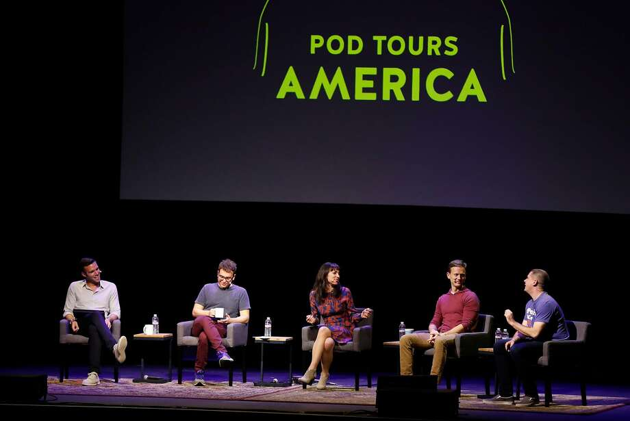 "Jon Favreau (left), Jon Lovett, Erin Gloria Ryan, Tommy Vietor and Dan Pfeiffer, the talking-heads cast of the political podcast comedy show ""Pod Save America,"" play to a sold-out Fox Theater crowd in Oakland. Photo: Scott Strazzante, The Chronicle"