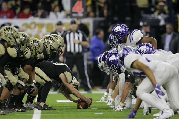 A view down the line of scrimmage as the Foster Falcons attempt a field goal during the high school football playoff game between the Foster Falcons and the Angleton Wildcats at NRG Stadium in Houston, TX on Friday, December 8, 2017.