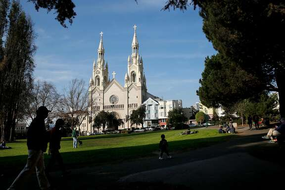 Washington Square full of activity on a sunny day on in San Francisco, Calif., on Thursday December 7, 2017.