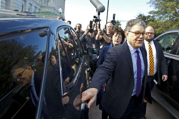 Sen. Al Franken, D-Minn., center, holds hands with his wife Franni Bryson as he leaves the Capitol after speaking on the Senate floor, Thursday, Dec. 7, 2017, on Capitol Hill in Washington. Franken said he will resign from the Senate in coming weeks following a wave of sexual misconduct allegations and a collapse of support from his Democratic colleagues, a swift political fall for a once-rising Democratic star. ( AP Photo/Jose Luis Magana)
