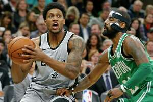 San Antonio Spurs forward Rudy Gay (22) drives around Boston Celtics guard Kyrie Irving (11) during second half action Friday Dec. 8, 2017 at the AT&T Center.