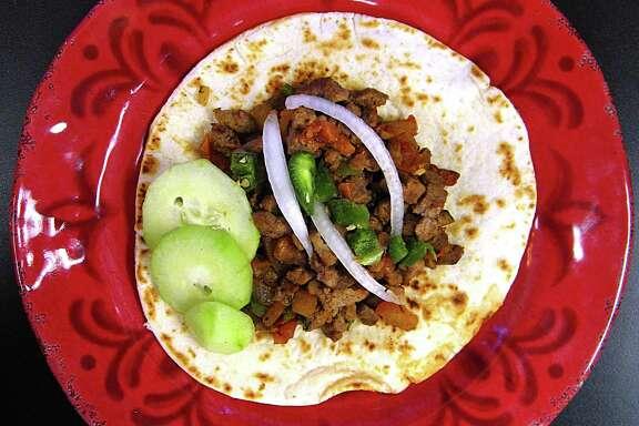 Carne asada a la mexicana taco on a handmade flour tortilla from Mike's Taco House.