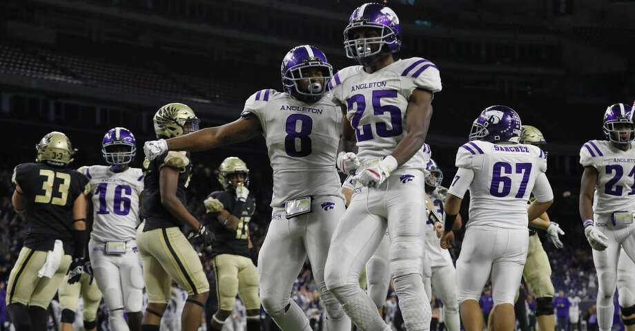 Angleton Wildcats Sincere Jackson (8) congratulates free safety B.j. Foster (25) after a fourth quarter touchdown during the high school football playoff game between the Foster Falcons and the Angleton Wildcats at NRG Stadium in Houston, TX on Friday, December 8, 2017. Photo: Tim Warner/For The Chronicle