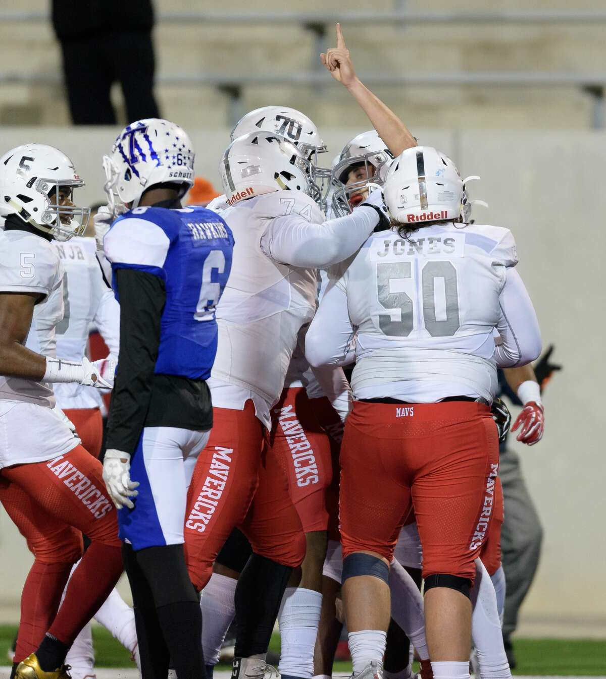 Kason Martin (12) of the Manvel Mavericks celebrates his touchdown in the second half with Lance Jones (50), Steven Shaw (70), and Jalen Momerelle (74) in a game against the Temple Wildcats in a high school football game on Friday, December 8, 2017 at Blackshear Field at Prairie View A&M University.