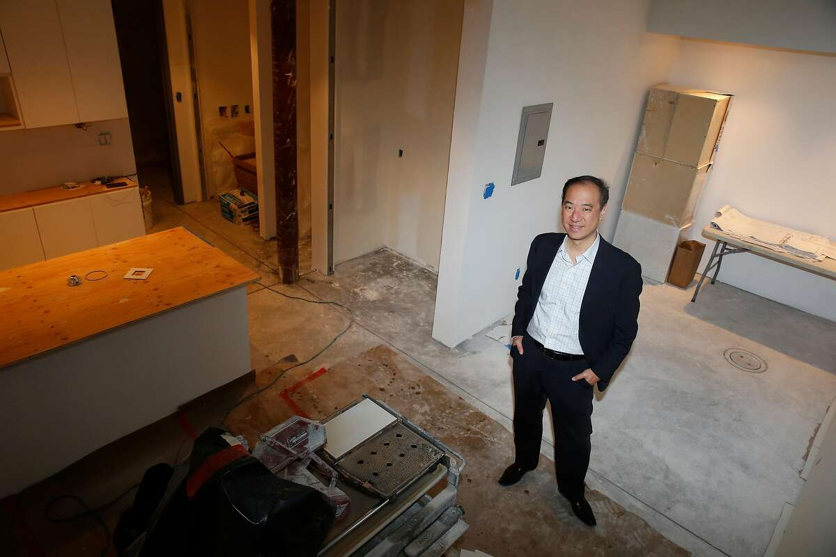 Yat-Pang Au, chief executive officer Veritas Investments, stands in one of 7 accessory dwelling units being added in an old common dining area at 735 Taylor on Wednesday, December 6, 2017 in San Francisco, Calif.