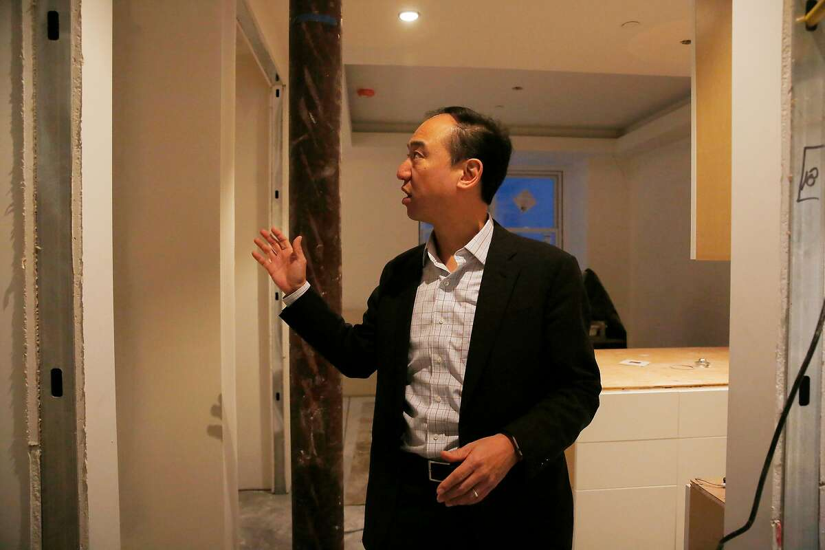Yat-Pang Au, chief executive officer Veritas Investments, looks over a washer and dryer area in one of 7 accessory dwelling units being added in an old common dining area at 735 Taylor on Wednesday, December 6, 2017 in San Francisco, Calif.